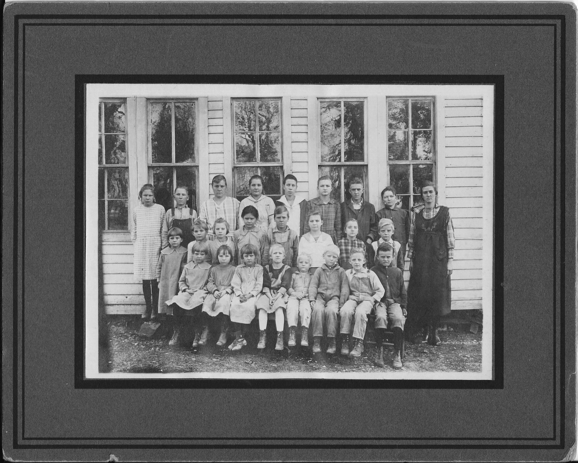 Top row: Mildred Gann, Garret Boyd, Dorothy Gann, Virgie Gann, Sylvia Granes, Pearl Gann, Fred Gann, Herbert Gann, and teacher, Minnie Pinkley. 2nd row: Elmerine Gann, Linna Gann (twin of Lonnie), Gladys Gann, ?? Pinkley, Dalton Gann, Wilma Gann, Vera Gann, Virgil Gann. Bottom row: Margarine Gann, Daisy Gann, ? Pinkley, Ethel Boyd, Cecil Gann, Ralph Gann, Lonnie Gann, ?? Pinkley.